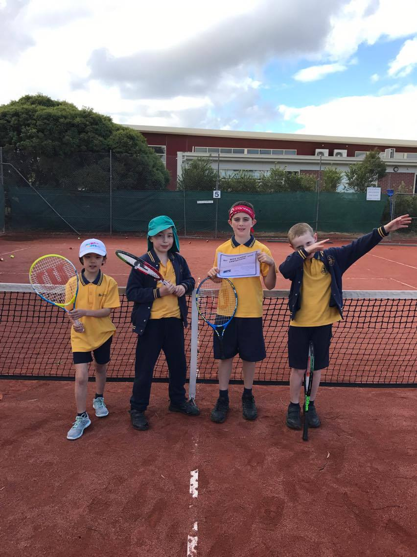kids at a tennis lesson