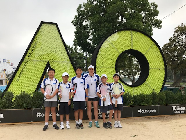 tennis coach with students