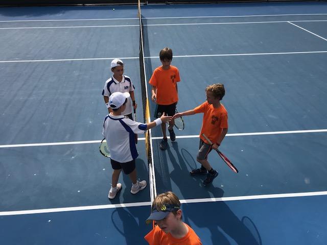 hand-shake after tennis match